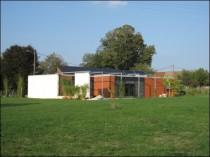 Une maison positive ossature bois bardage tuiles à Chevigney-sur-l'Ognon